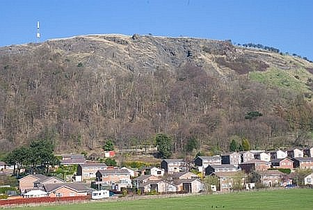The volcanic vent of the Binn dominates the town
